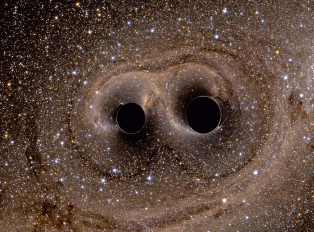 Merging of the two black holes of different masses. Credit: Discovery Magazine Blog